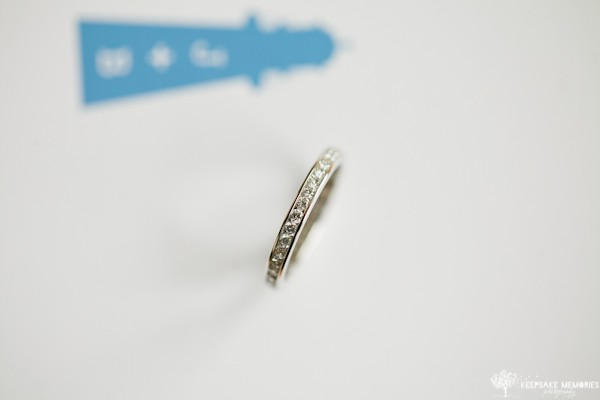 wedding ring shot in invitation