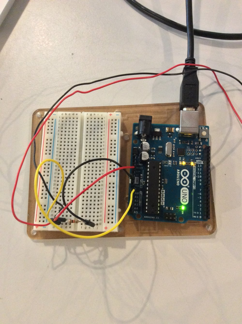 Arduino and Breadboard circuit: Analog Input 0 (yellow wire) , Ground (black wire), 3.3v Power from Arduino (red wire)