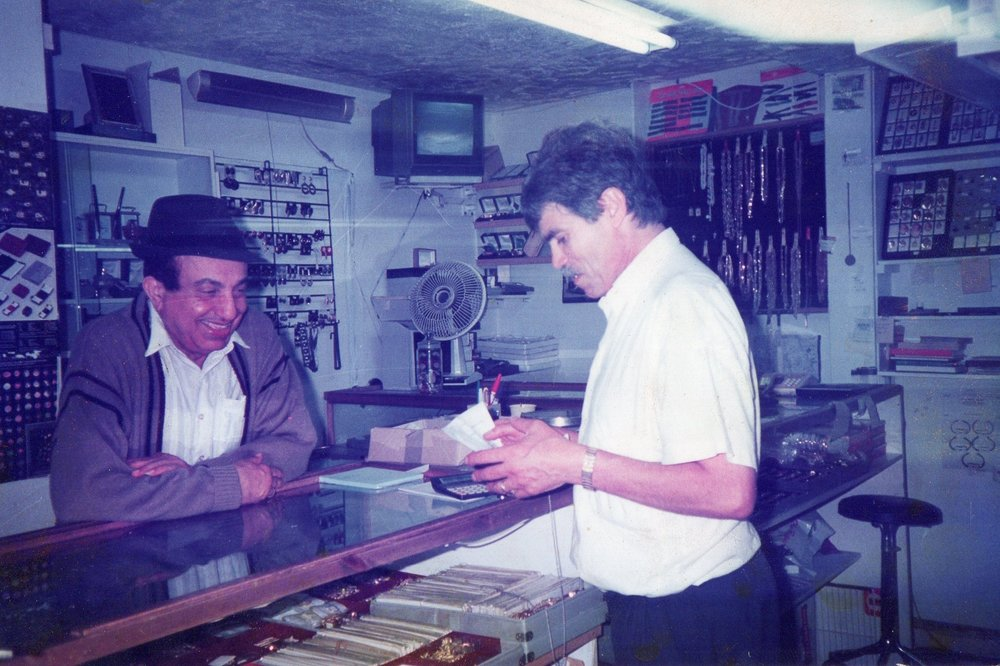 Shalom serving a customer in 1978.