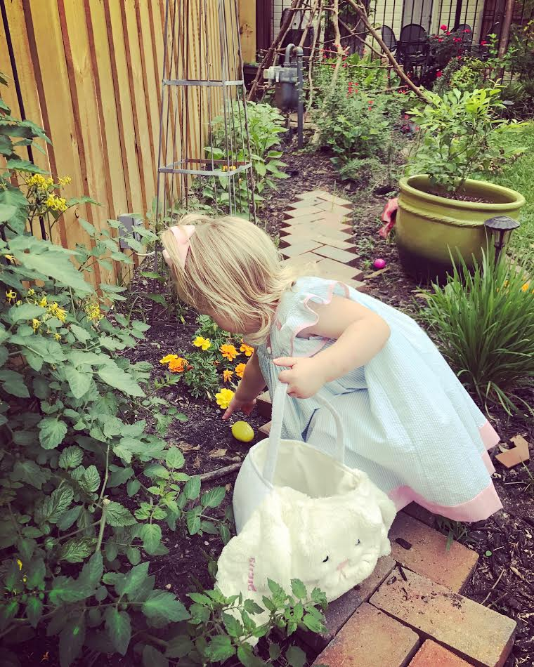 Hunting Easter eggs in the garden. Basket from  Pottery Barn Kids .