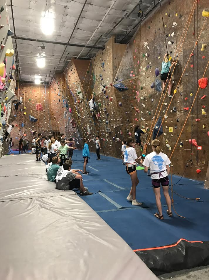 Youth climbing at Summit Climbing Gym in Dallas, TX.