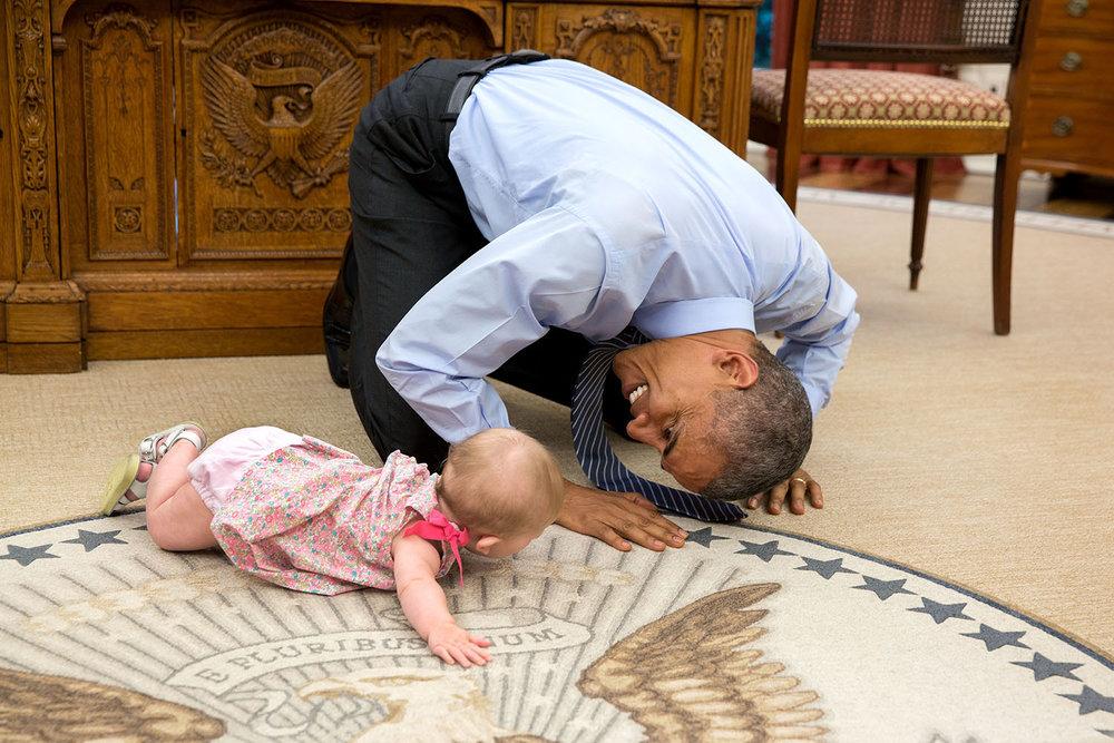 Barack_Obama_crawling_with_Ella_Rhodes.jpg