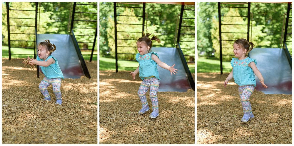 these are images of a toddler at a playground in atlanta georgia at piedmont park. she is tossing the wood chips from the playground into the air and jumping.