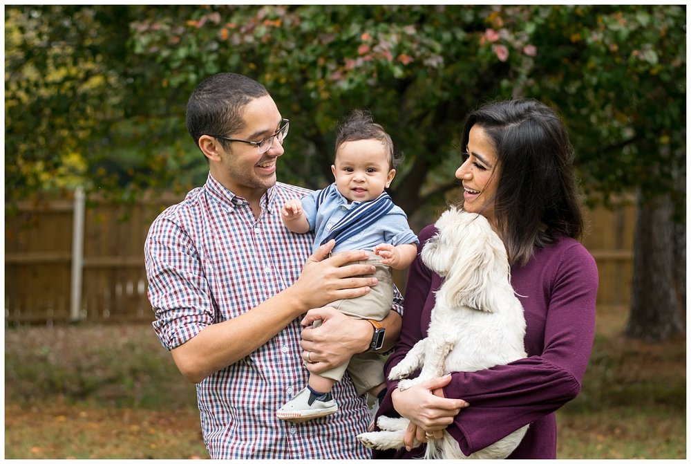 this is an image of a mother and father holding their six month baby boy during a lifestyle family session in marietta, georgia