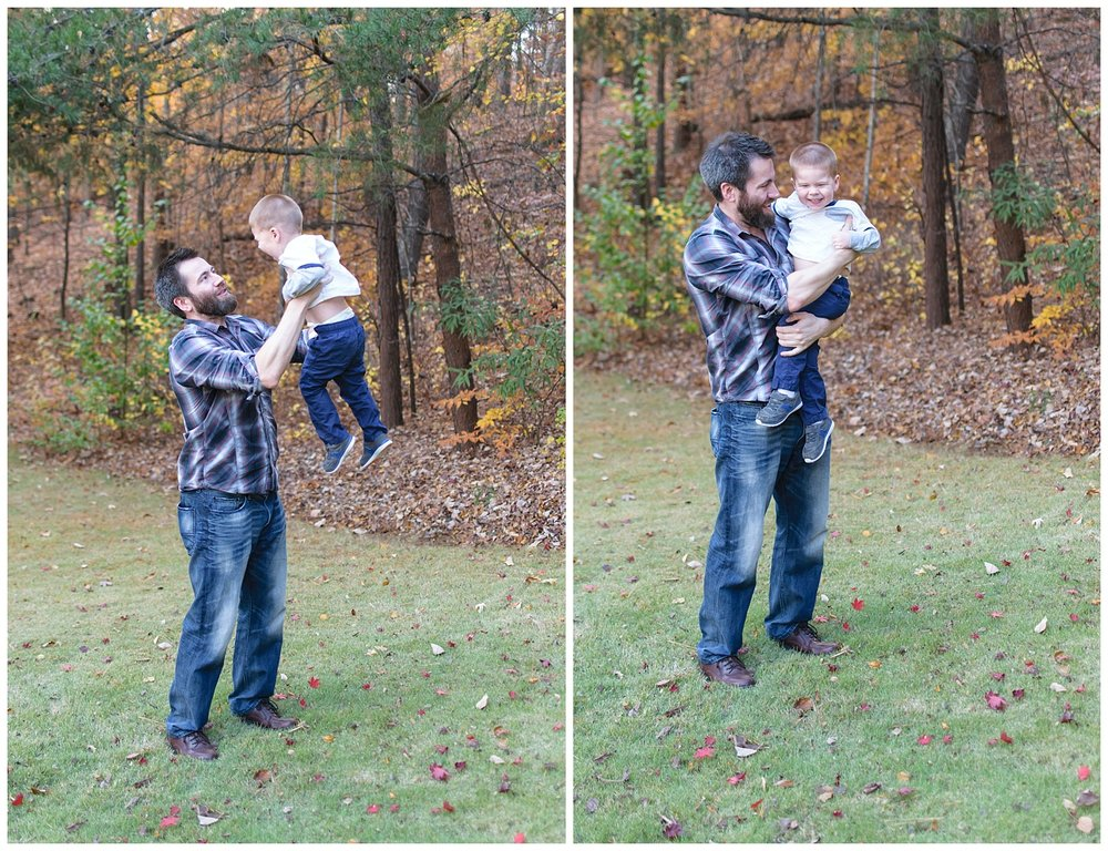 these are images of a dad holding his toddler son up and playing and hugging him in the frontyard.