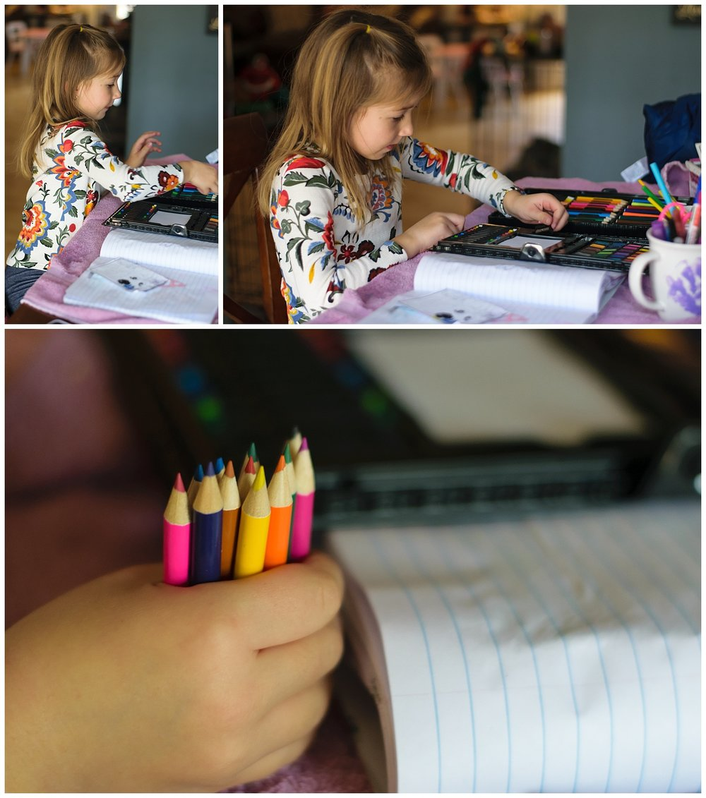 these are images of a girl inside sitting and coloring at the table.