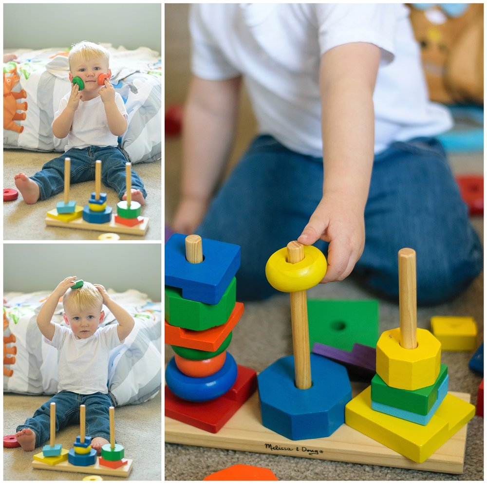 these images were taken during an in home lifestyle family session. the photos were taken in the young boy's room and the young boy is playing with blocks.