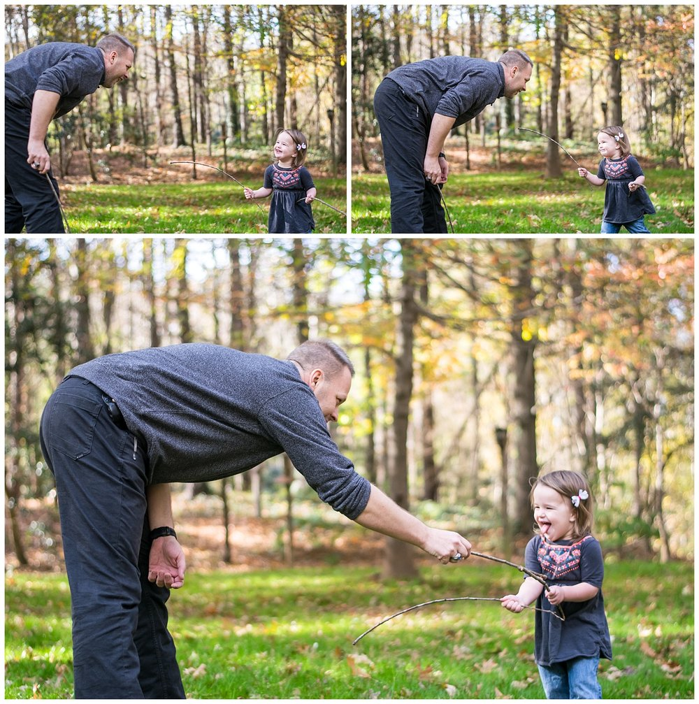 these are images of a dad and his toddler daughter playing with sticks at hahn woods in decatur georgia.