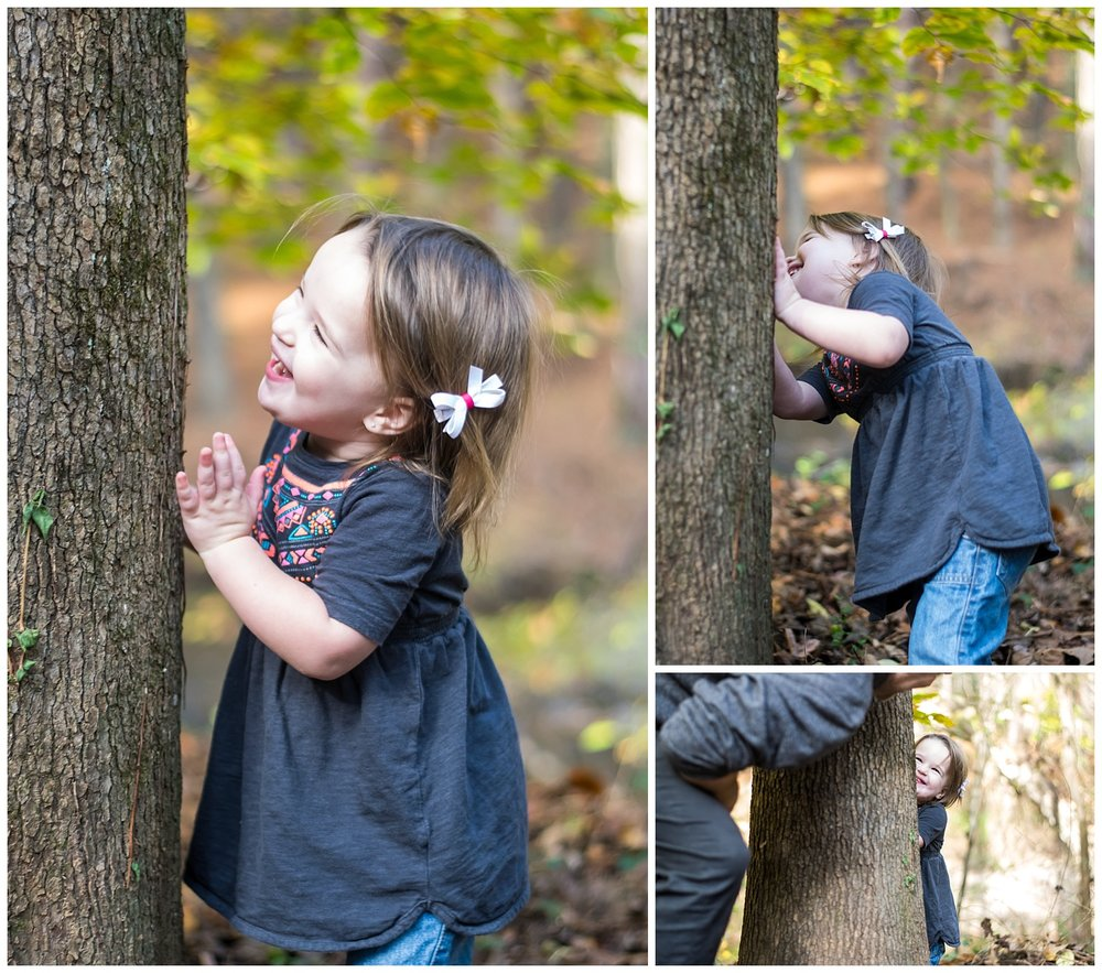 these are images of a dad and his daughter playing hide and seek behind a tree at hahn woods in decatur during a lifestyle family session.