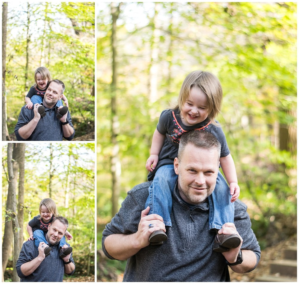 these are images of a dad giving his toddler girl a piggy back ride outside at hahn woods in decatur georgia.