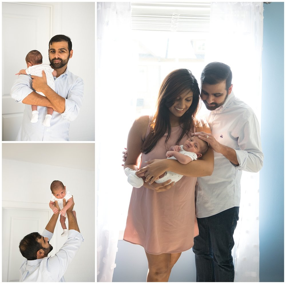 these are images of a mom and dad holding their newborn baby boy in the baby boy's nursery. dad is holding the baby and holding him up.