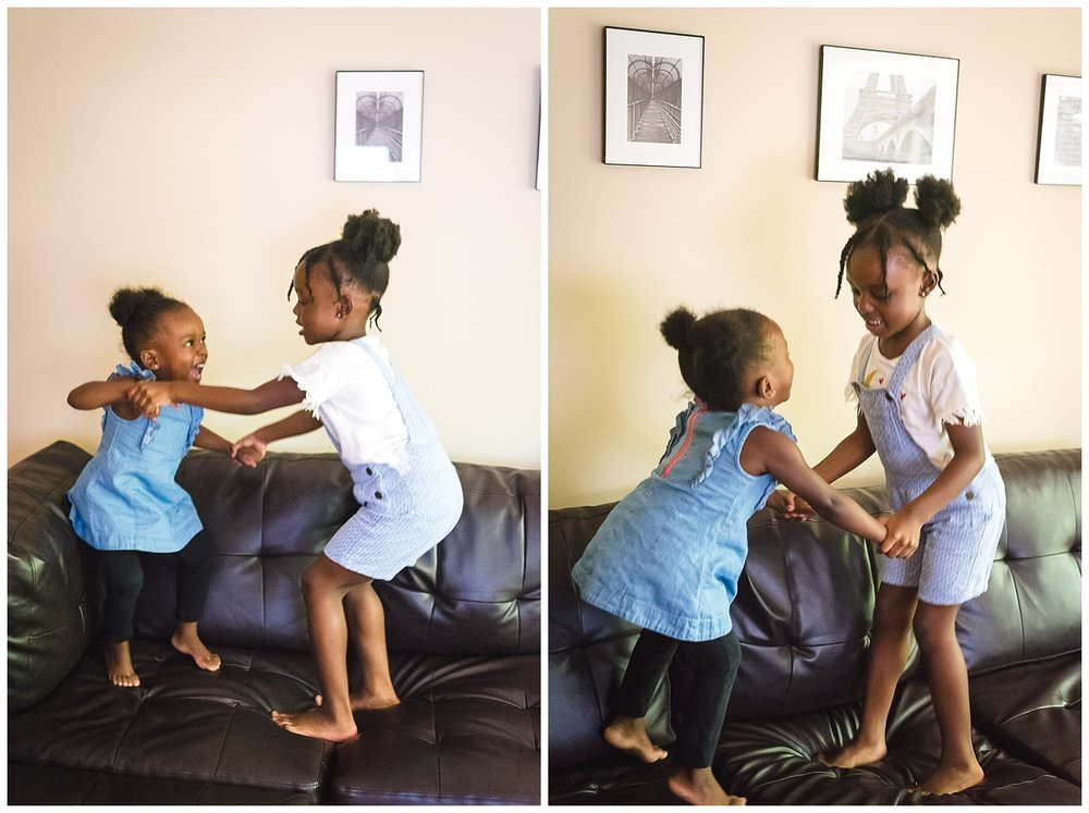 little-girls-jumping-on-couch-in-home-session