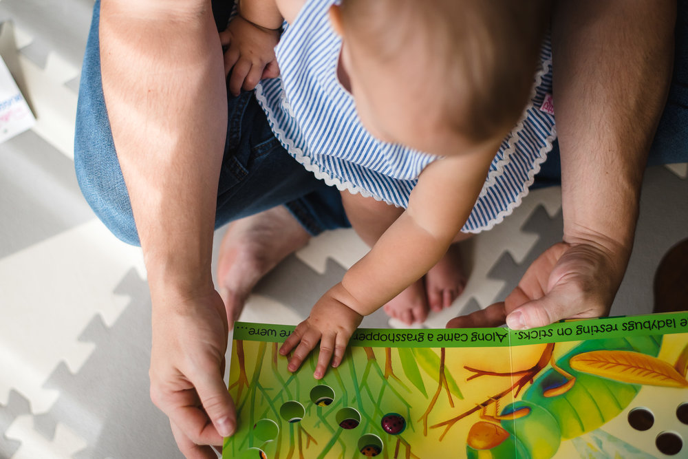 atlanta-family-photographers-toddler-reading-turning-page-of-book