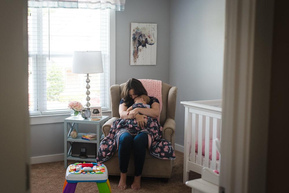 mom-holding-toddler-before-naptime-tabitha-maegan-photography