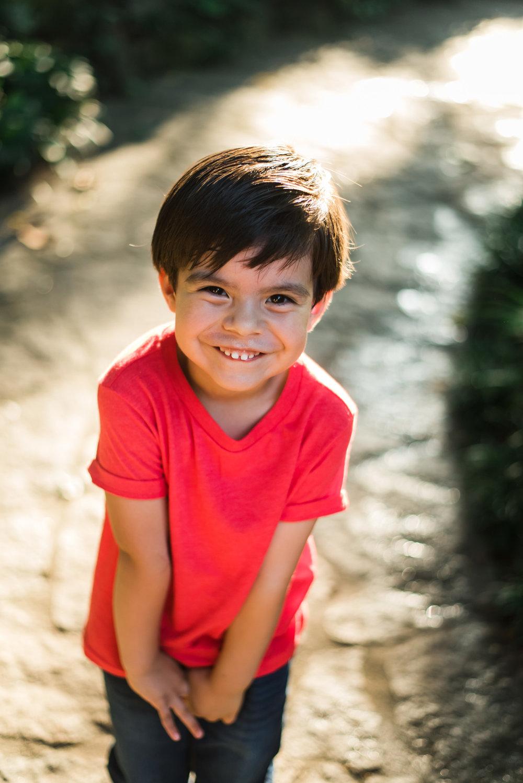 young-boy-smiling-at-camera-atlanta-family-photographers
