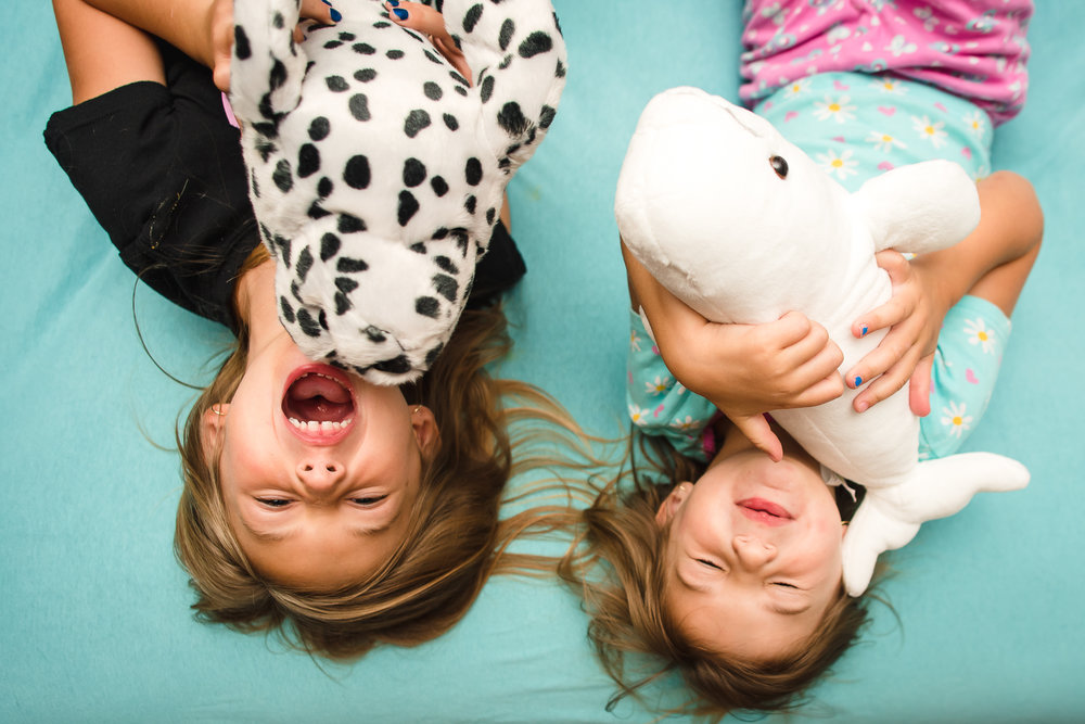 upside-down-sisters-playing-with-stuffed-animals-2