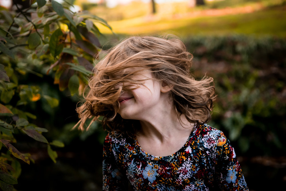 young-girl-shaking-head-messy-hair
