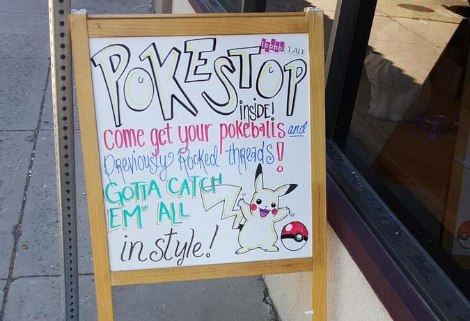 Sign at clothing store encouraging people to come in from playing Pokemon GO