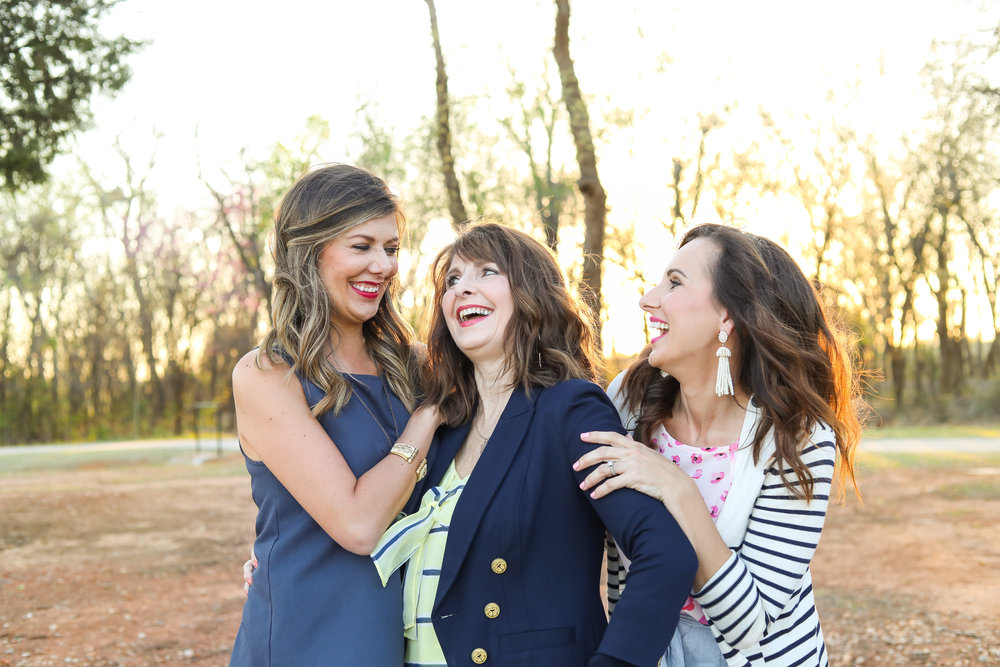 mother and her two grown daughters laughing