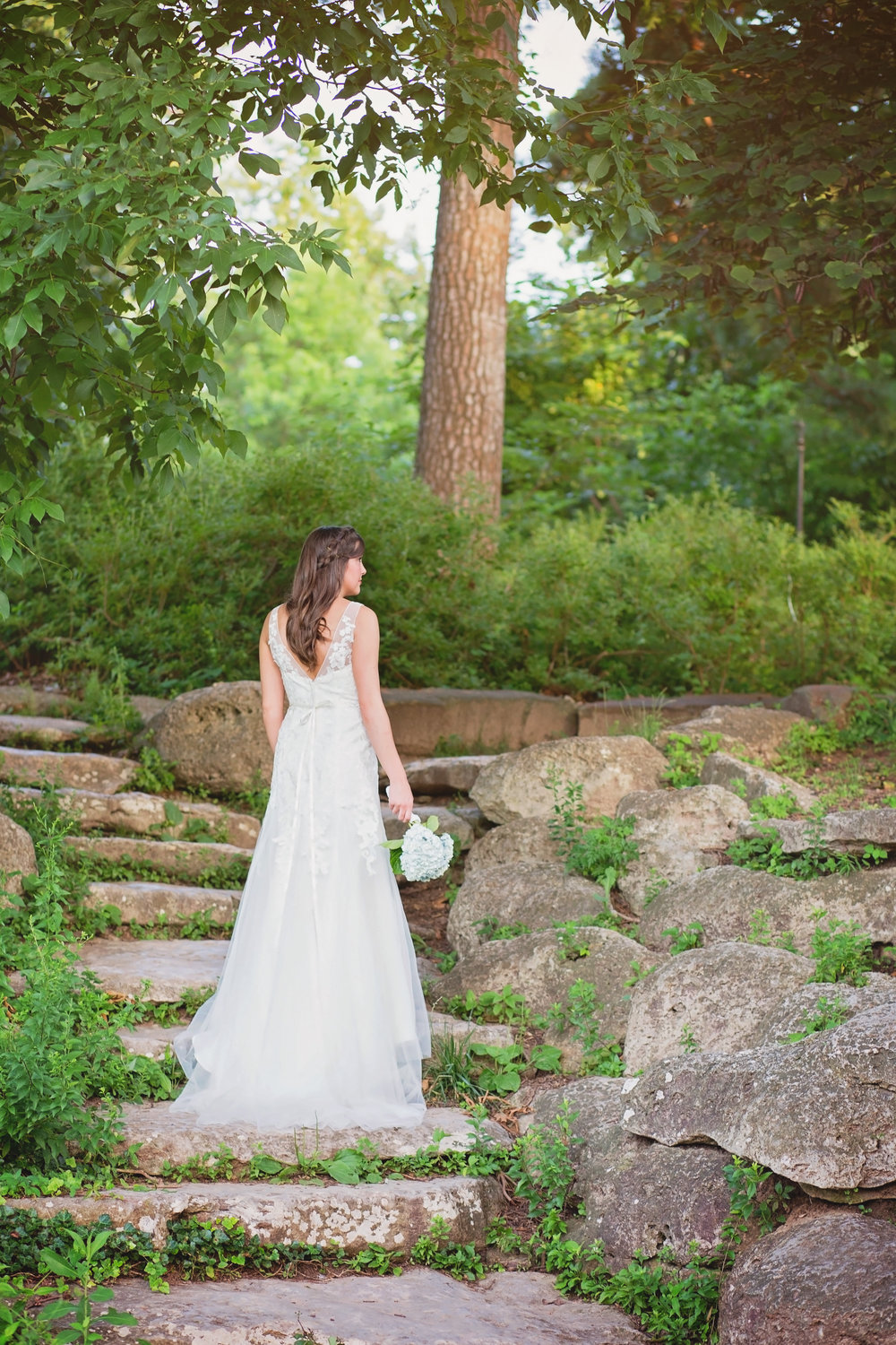bride standing on rock stair case looking away from camera tulsa oklahoma