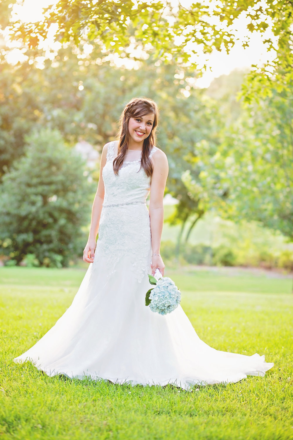 bride holding flowers standing in park in tulsa oklahoma