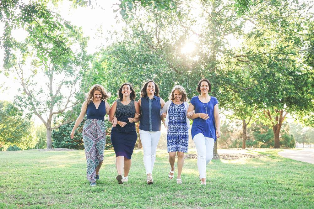 5 women wearing blue walking in park in Oklahoma City