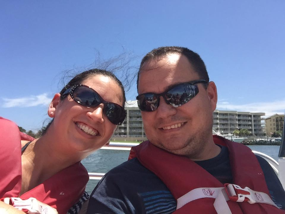 couple on a boat wearing red life jackets