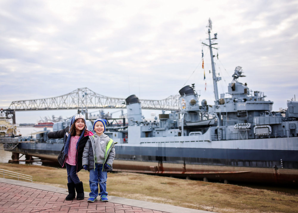 Siblings standing in front of the USS Kidd in Baton Rouge, LA.