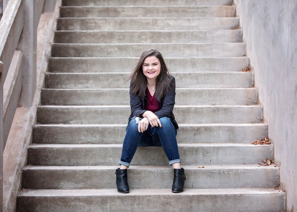 Oklahoma senior girl sitting on large white concrete stair case in downtown Oklahoma City by Amanda Lynn Photography.