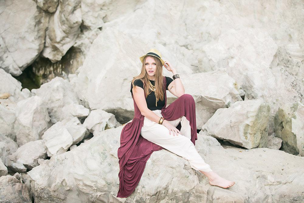 High School senior girl, sitting on rocks at Cannon Beach, Oregon, by Oklahoma City Senior Photographer, Amanda Lynn.