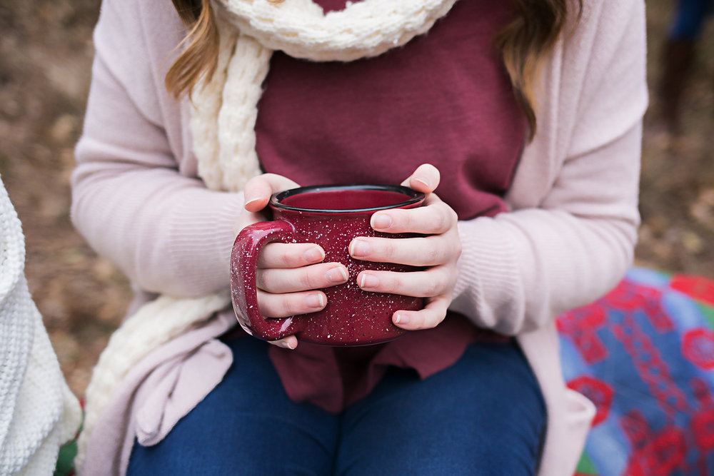 Close up image of senior girl holding red coffee mug by Amanda Lynn.
