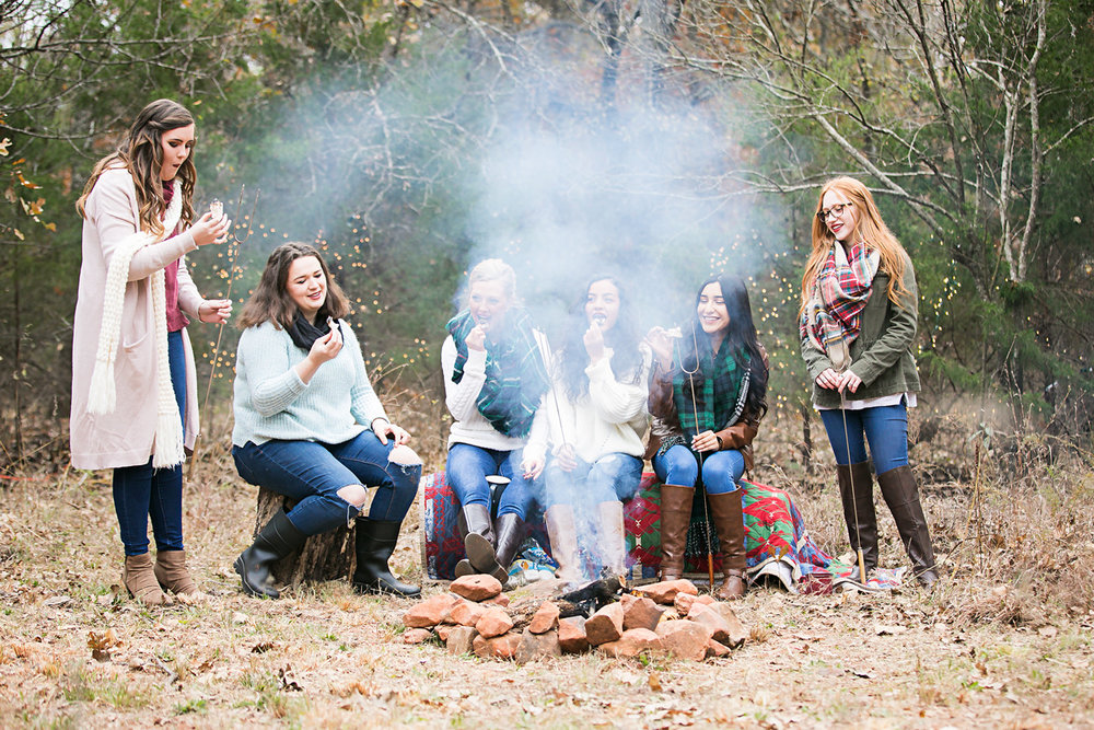 Oklahoma High School Seniors sitting around a camp fire in Oklahoma by Amanda Lynn.