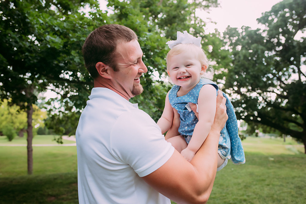 Family photography, father holding laughing little girl at Will Rogers Park in Oklahoma City by Amanda Lynn Photography.