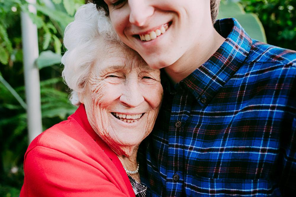 Great grandma and great grandson hugging at the Crystal Bridge in Oklahoma City by Amanda Lynn Photography.
