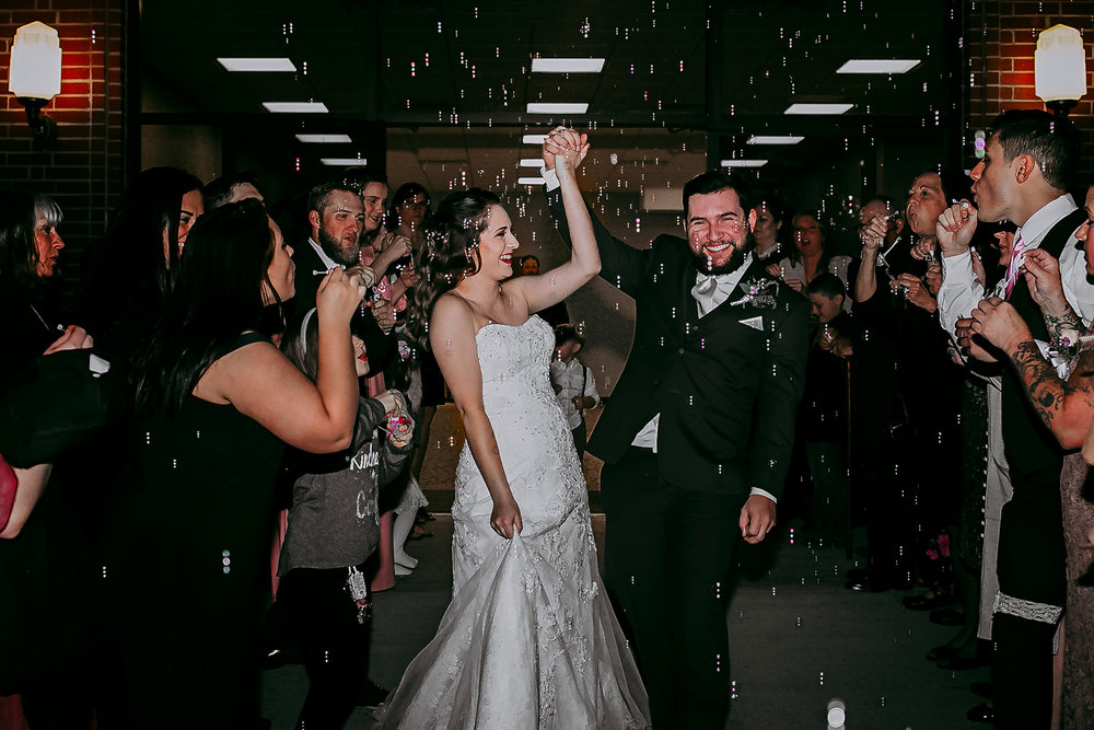 Bubble exit of bride and groom in Oklahoma City by Amanda Lynn