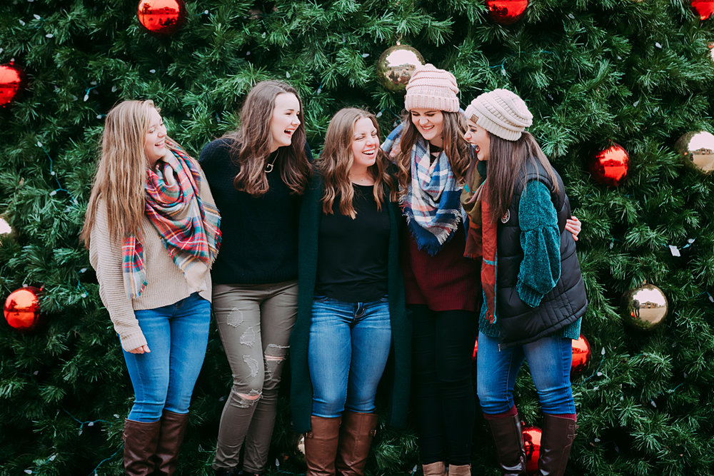 Amanda Lynn's Elite Senior Model Team, laughing and standing in front of Christmas Tree in downtown Oklahoma City.