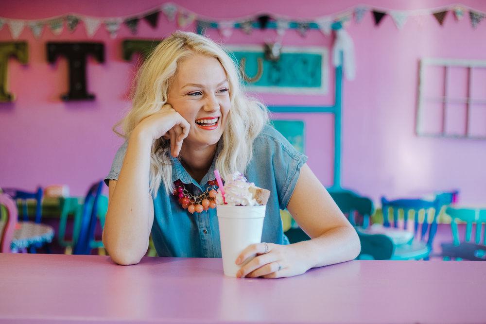 Oklahoma high school senior girl with blonde hair, sitting at table at Trailer Trash Treatz in Choctaw, Oklahoma.