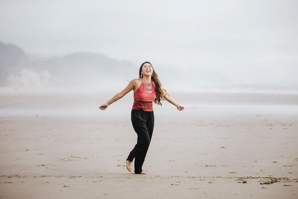 Senior girl dancing on the beach on the Oregon Coast by Oklahoma City Photographer Amanda Lynn.