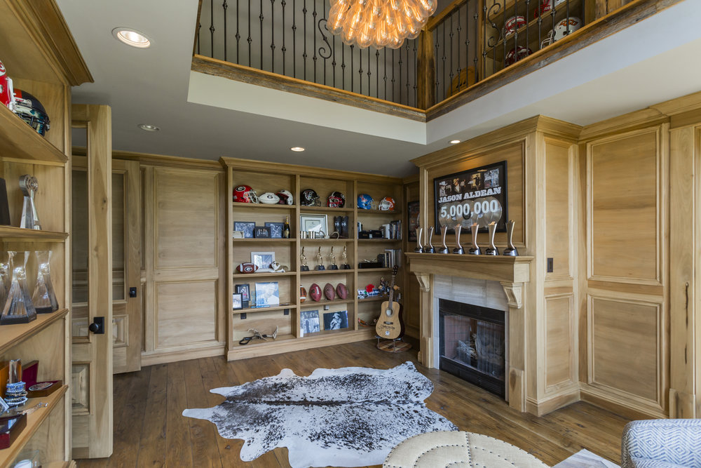 Features gas fireplace and custom book shelves.