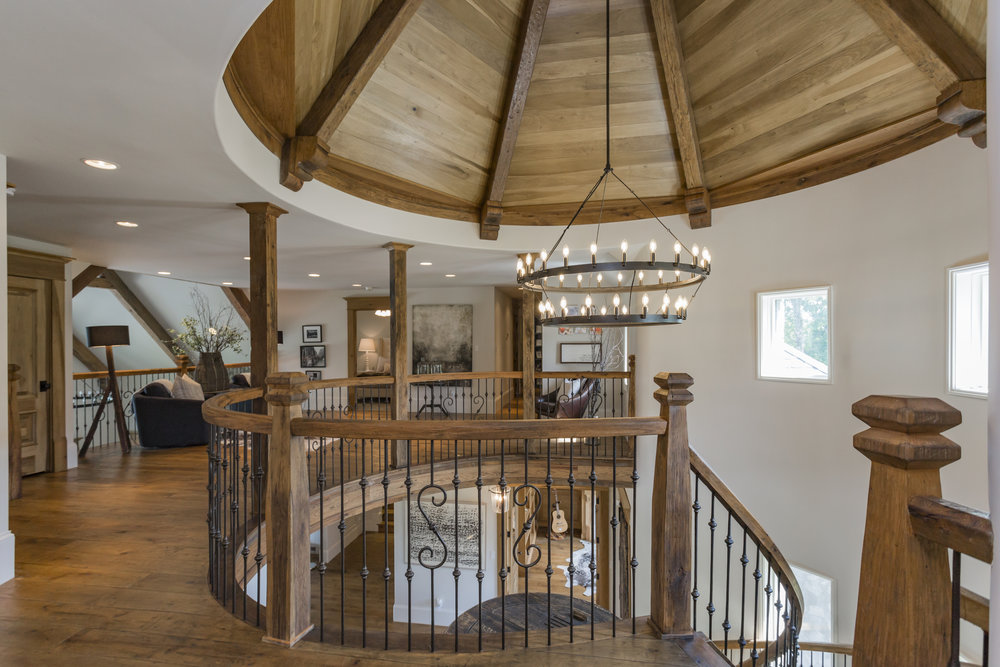 Barreled ceiling in entry features custom wood finishing.