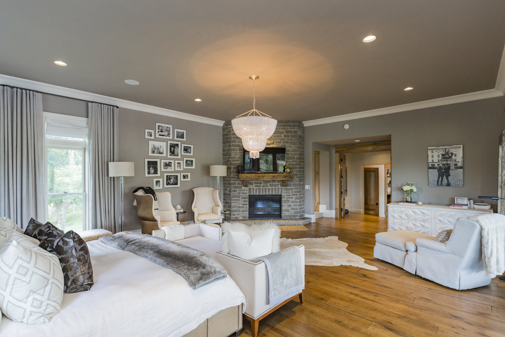 Breathtaking Master Suite features a gas fireplace, his/her closets, reclaimed wood cabinets.
