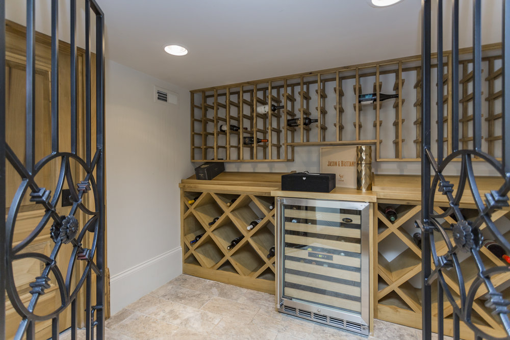 Bonus space in the basement, featuring a wine cellar, small refrigerator and sink.