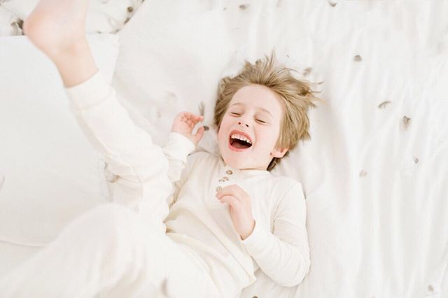 Let a 5 year old jump on a bed with a feather pillow and there is no posing necessary