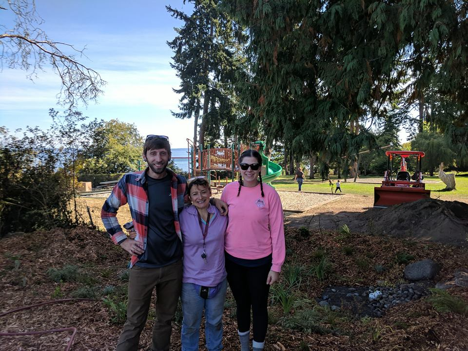 Zach, Erica and Hannah in front of a newly installed rain garden in Chetzemoka park