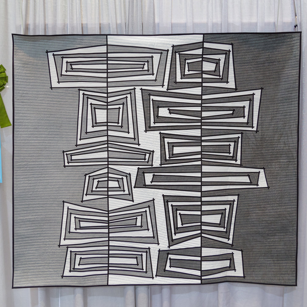 """1st Place: Inside Out  61"""" x 54"""" Pieced and quilted by Susan Bleiweiss Pepperell, MA, United States Individual MQG Member"""