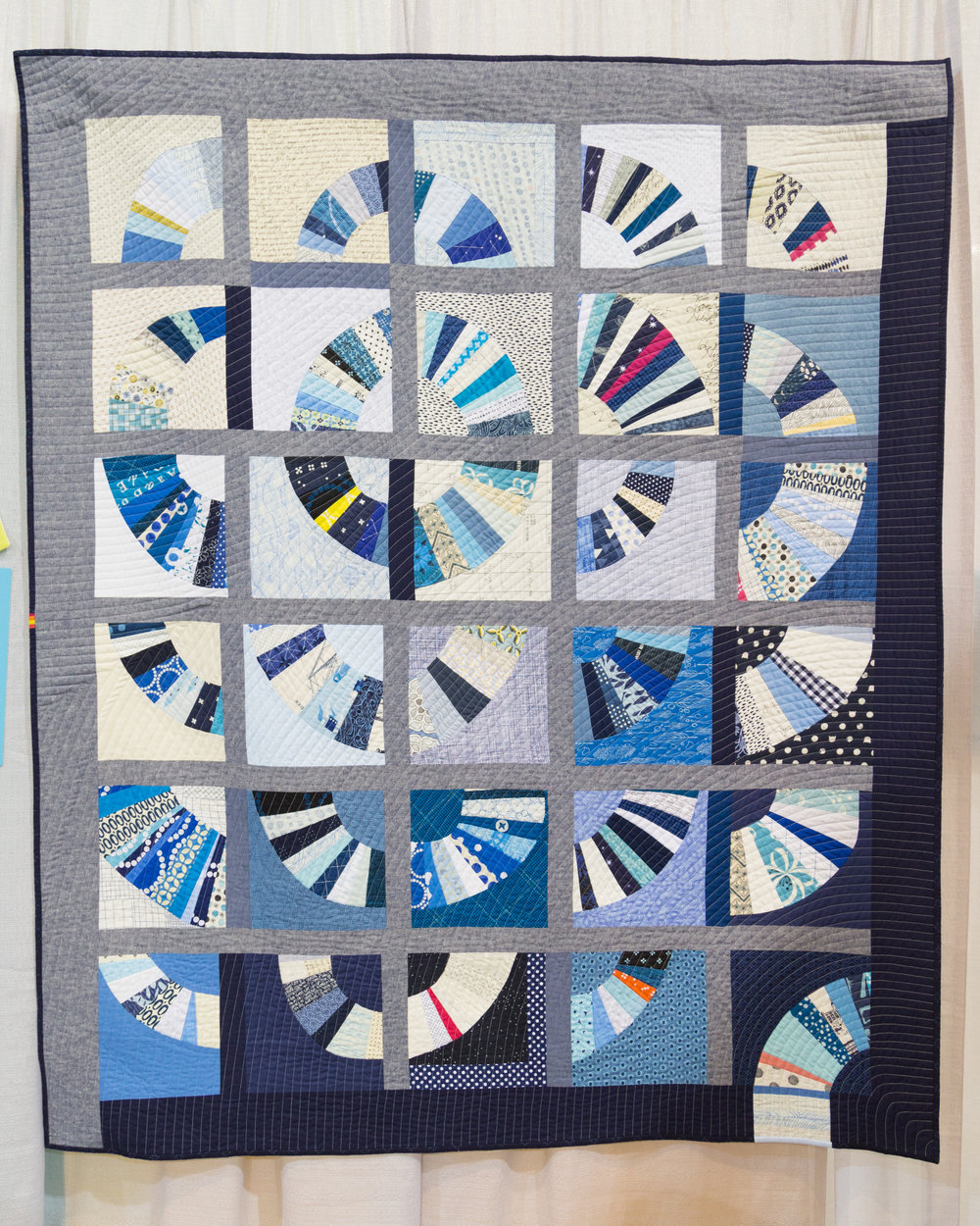 """2nd Place: Blue Blue Electric Blue  52"""" x 61"""" Pieced and quilted by Ara Jane Olufson, Deborah Aspuria, Daisy Auschehoug, Ivy Bagnall, Yeechi Chen, Cat Downs, Mary Gibbons, Rachel Hauser, Allison Schnackenberg, and Jodie Wu. Seattle, WA, United States Seattle Modern Quilt Guild"""