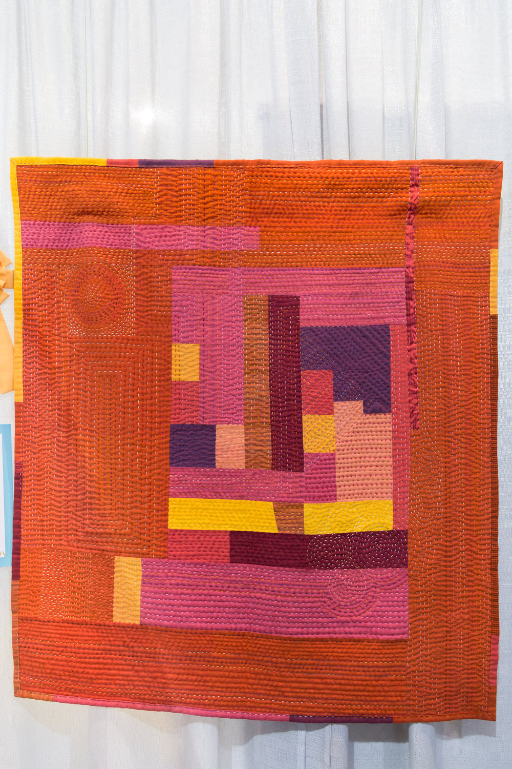 """3rd Place: Trust Your Gut  39"""" x 43"""" Pieced and quilted by Marilyn Butler Kansas City, MO, United States Kansas City Modern Quilt Guild"""
