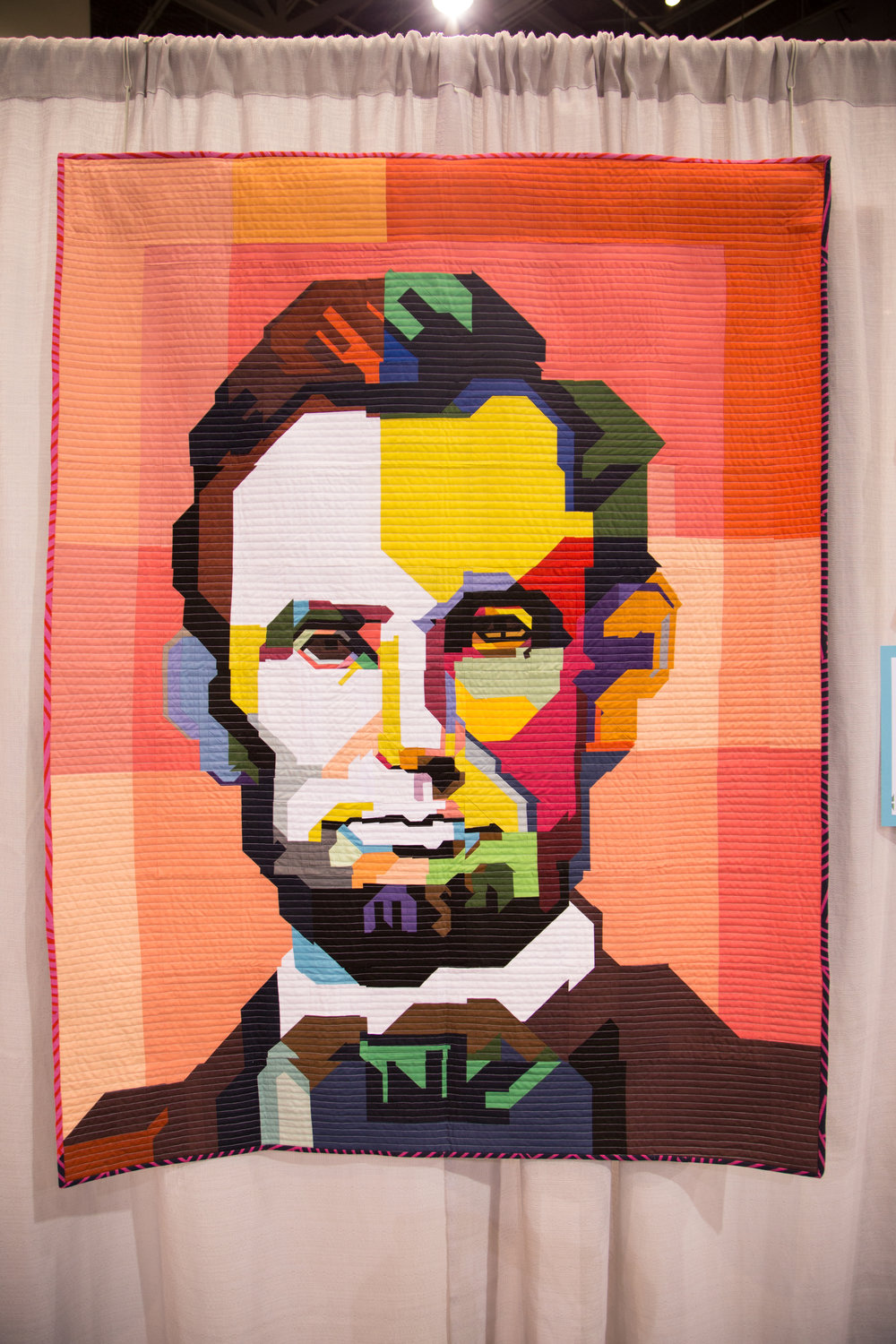 """1st Place: Lincoln  46"""" x 60"""" Pieced and quilted by Kim Soper Huntington, NY, United States Individual MQG Member"""