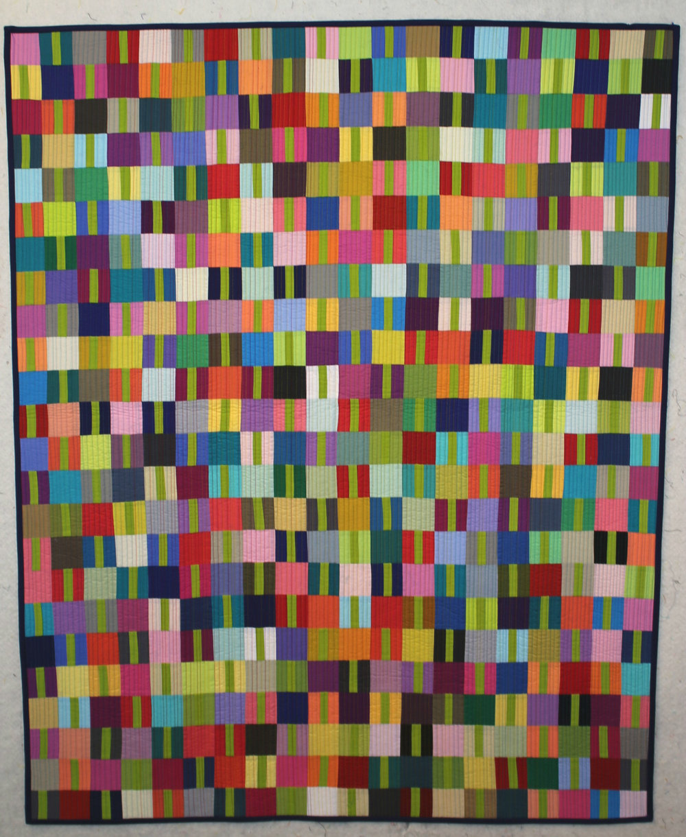 """2nd Place: Finding The One  39"""" x 48"""" Pieced and quilted by Miriam Coffey Lake Junaluska, North Carolina, United States Asheville Modern Quilt Guild"""