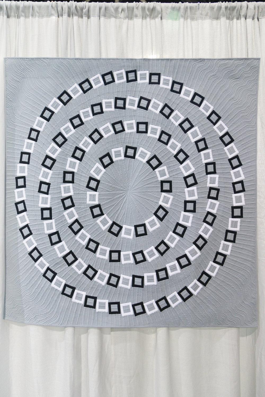"Vertigo  56"" x 56"" Pieced and quilted by Elaine Poplin Huntsville, Alabama, United States Individual MQG Member"
